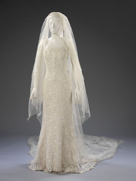 Wedding gown with double-camisole straps and a short train. Ivory lace with pearl beading. l Victoria and Albert Museum