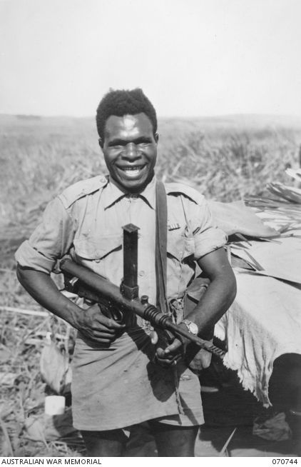 """KELANOA, NEW GUINEA. 1944-03-04. 480 CORPORAL SALA, MM, """"A"""" COMPANY, 1ST PAPUAN INFANTRY BATTALION. """"A"""" COMPANY ARE PAST MASTERS IN JUNGLE WARFARE. LED BY EXPERT AUSTRALIAN OFFICERS AND NON ..."""
