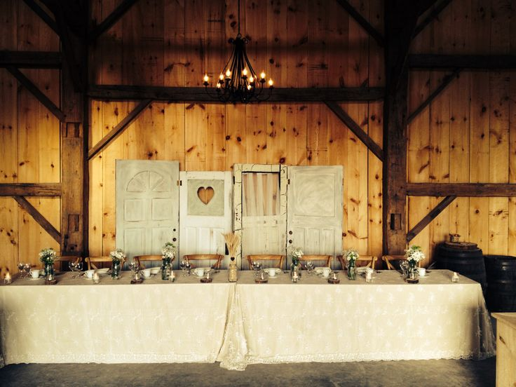 Head table with deco doors burlap and mason jars.