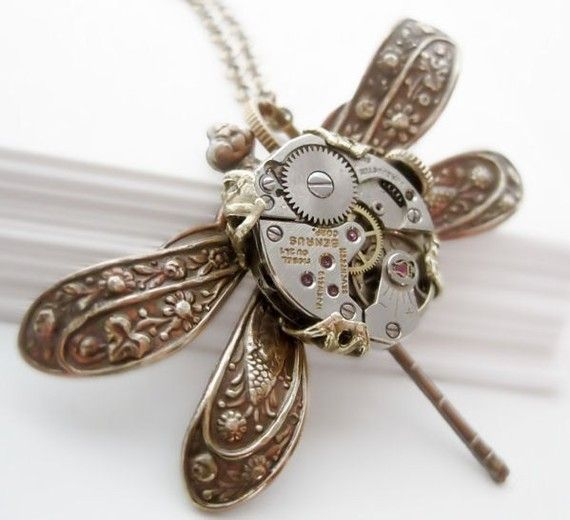 By Vintage Filigree: SteamPunk necklace featuring an urban dragonfly which takes flight carrying on it's body a vintage watch mechanism with ruby jewels. Gorgeous and very impressive insect jewellery design depicting how time flies.