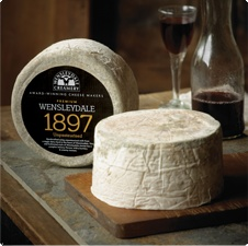 1897 Unpasteurised Wensleydale cheese. Handcrafted using unpasteurised milk from a single dairy herd in the heart of Wensleydale. This old-fashioned style of Wensleydale cheese has a complex lemony flavour with a buttery and creamy texture.