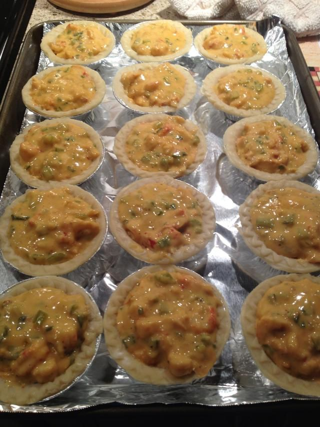 Fill each shell with the crawfish mixture. I got about 30 pies out of this double batch. Toss them into a 350 degree F oven for 15-30 mins until it's bubbly and starting to brown on top.