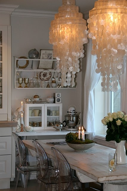 Modern shabby chic.  Love the chandelier...for the dining room.
