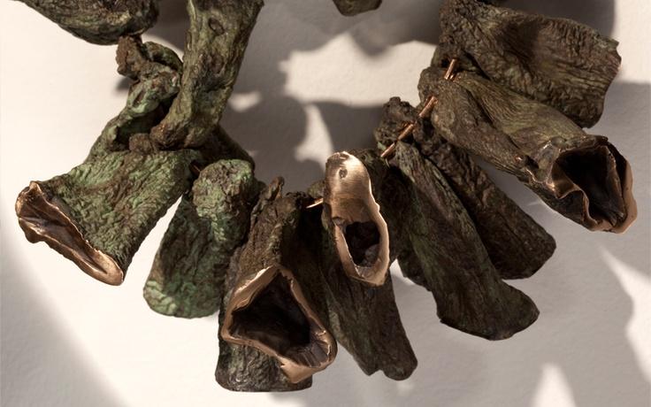 Cléa van der Grijn  Ambivalence 23 May - 22 June 2013 Mother (aubergine necklace) 30x23cm  Bronze with patina (24 Pieces)