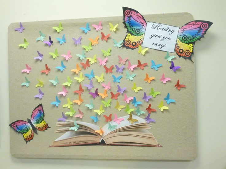 Reading gives you wings bulletin board...butterflies coming out of the pages of a book.
