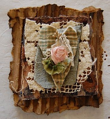 Rustic heart - LOVE this, if I did something similar, I'd probably use similar materials and do on a larger scale, love the corrugate, bit of lace, fabric heart (quilted gingham?) and the boquet