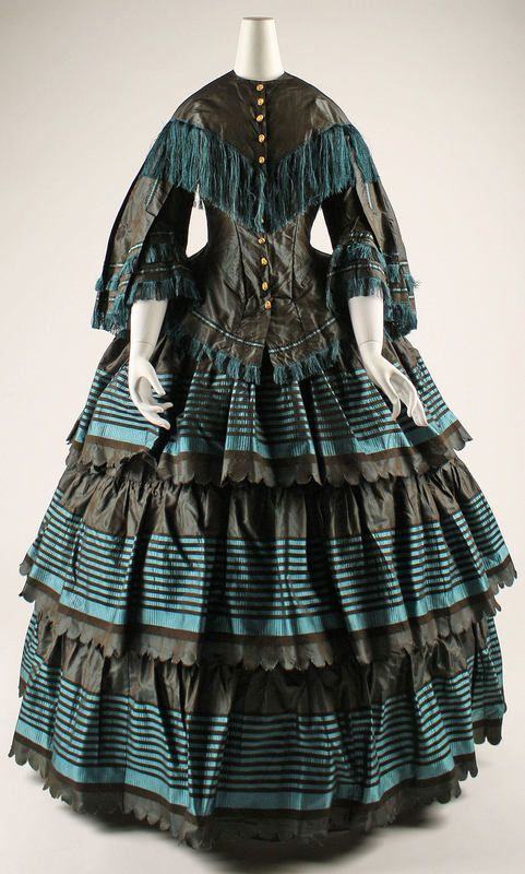 1860's 2-Piece Tea Gown or Day dress, black & teal border print skirt, 3 flounces; solid black bodice trimmed with braid & teal fringe.