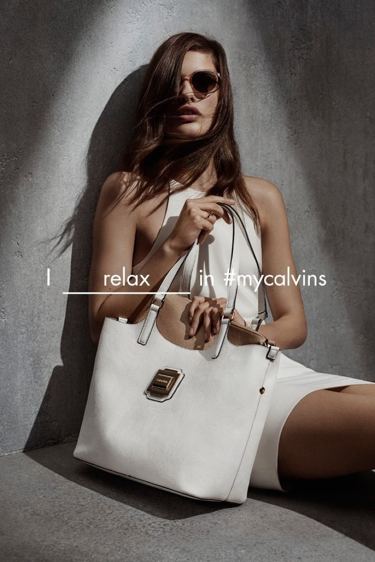 Posing with sunglasses and an oversized tote, Julia models a white mini dress from Calvin Klein White Label's spring 2016 collection