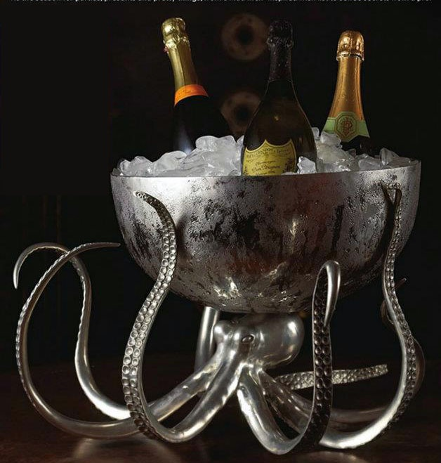 "Vagabond House's top of the line, ""over the top"" kraken style, pure pewter and hammered steel Octopus holds half of the globe in his writhing tentacles, creating a truly remarkable hammered and polished stainless steel ice tub, drink cooler or punch bowl for your special occasion. Crafted with exquisite detail and our signature mission of capturing the essence of marine life in pure pewter, every pod on our octopus's tentacles is perfectly realistic."