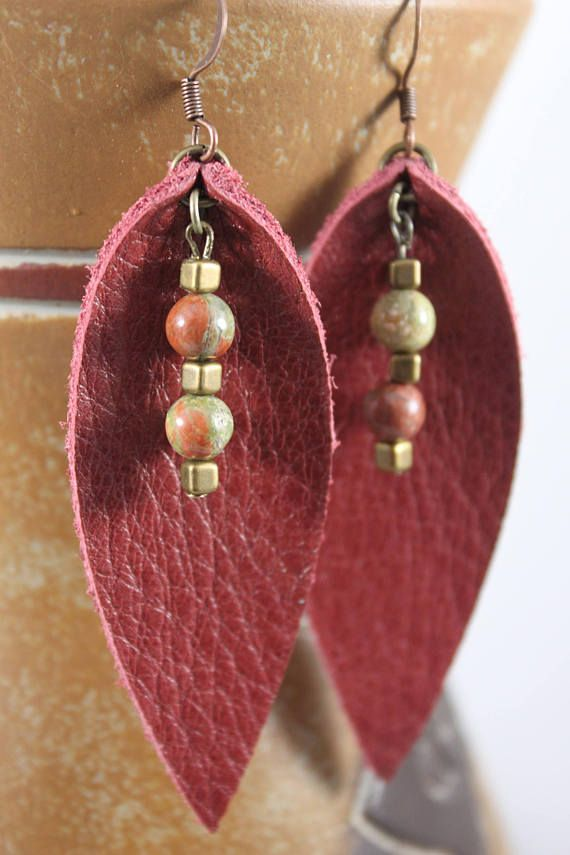 Trendy leather earrings with beading that sets them apart from the ordinary! The leather is lightweight and soft with a pebble grain on the front & suede like texture on the back. Two 6 mm round unakite beads and three 3 mm antique brass square beads on each earring accent the