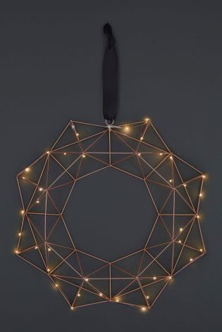 With copper being a top trend this year, it would be rude not to treat yourself to this Lit Copper Finish Geo Wreath from Next. Pop in on your front door, in your bedroom or on your living room wall to give your home a touch of sparkle this Christmas.
