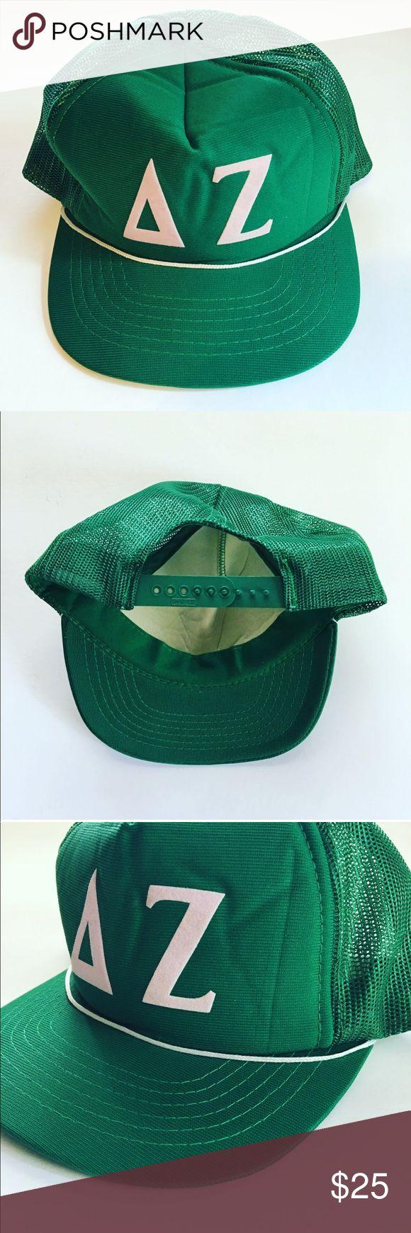 ΔΖ Vintage Delta Zeta Trucker Hat ΔΖ Vintage Delta Zeta Trucker Hat ⚡︎ DETAILS:  ⌁ BRAND: ✘  ⌁  FEATURES: 5 panel cap; seamless foam front panel with lining; mesh back panels; delta/zeta letters are made of felt fabric; 6 rows of stitching on visor; white color braid; plastic adjustable snap;  ⌁ SIZE: one size (plastic adjustable snap) ⌁ COLOR: green / powder pink letters ⌁ CONDITION: excellent  ⌁ CONTENT: ✘  ⌁ CARE: ✘  ✘ no trades, no PayPal ✘ Vintage Accessories Hats