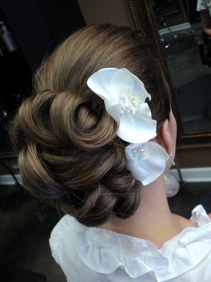 some brides also opt for paper flowers to adorn their great up-do's like one of our brides here!  they still look great and adds just another little touch to her hair