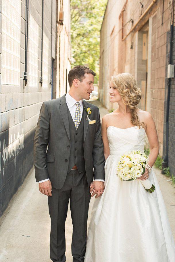 Dark grey suit with vest and light tie for groom, groomsmen with navy tie.