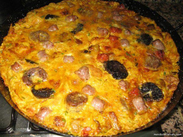 """Arroz y Costra El arroz y Costra es una de las comidas típicas en Elche, Orihuela y su entorno. En Orihuela también le llaman """"tesoro escondido"""" por que la costra de huevo impide ver al…"""