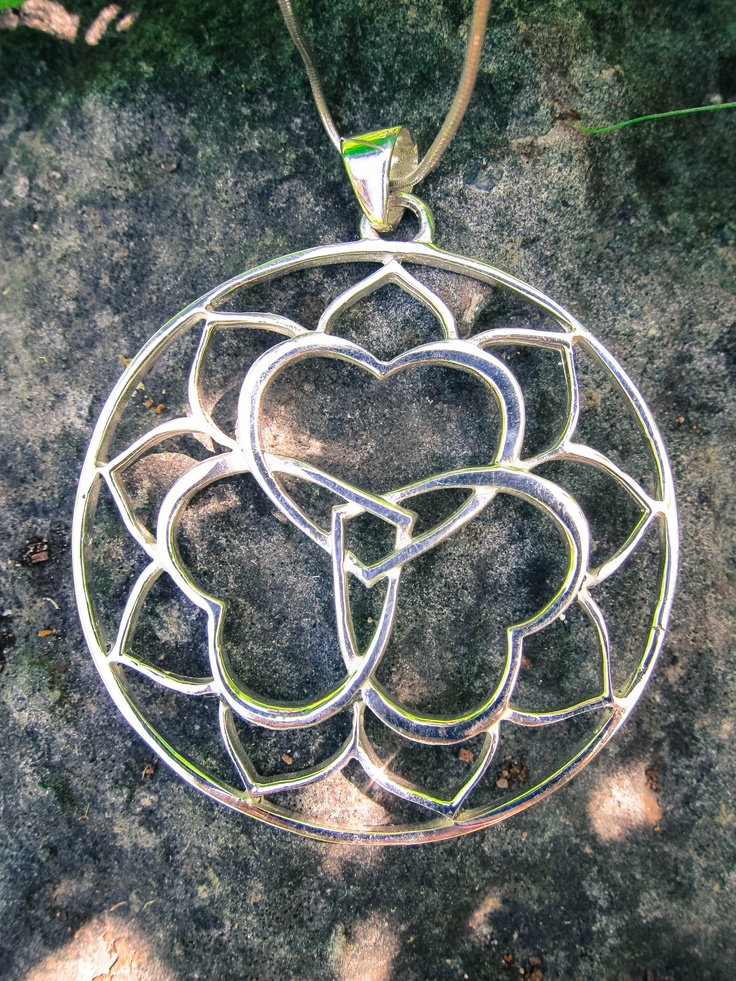 You Are Infinite Designs  https://www.etsy.com/listing/153273824/triple-yum-sterling-silver-pendant?ref=shop_home_feat