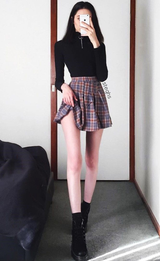 Long sleeved black top with plaid skirt & combat boots by steqhs