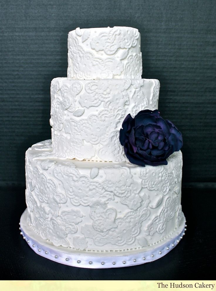 Lace Wedding Cake with eggplant flower. Featured in NJ Brides Magazine.