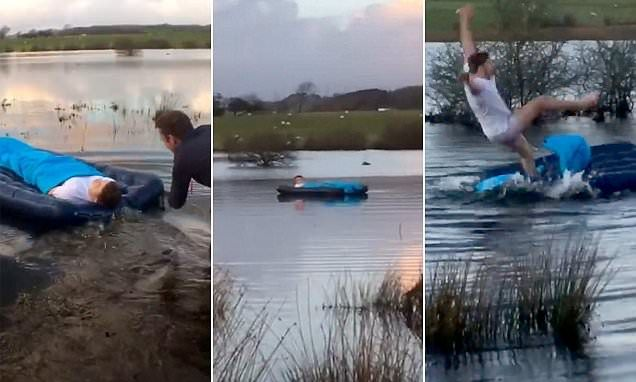 Internet trickster Ben Phillips from Bridgend, Wales filmed himself dragging close pal Elliot Giles from his tent while he was asleep on an airbed and pushing him into a lake.