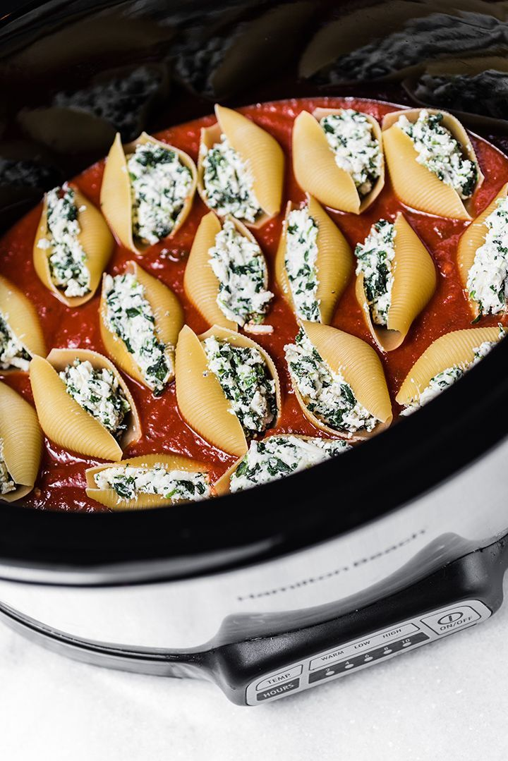 Did you know you can cook pasta in the slow cooker?  We took raw pasta shells and cooked them directly in the slow cooker for our Stuffed Shells with Spinach. We started with large uncooked pasta shells and filled them with a combination of frozen …