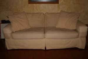 Butter cream cotton upholstery sofa (86W X 40D X 34H) with 2 large waffle textured pillows. Comfortable! From Storehouse furniture. Great condition!  $200 (South Austin)