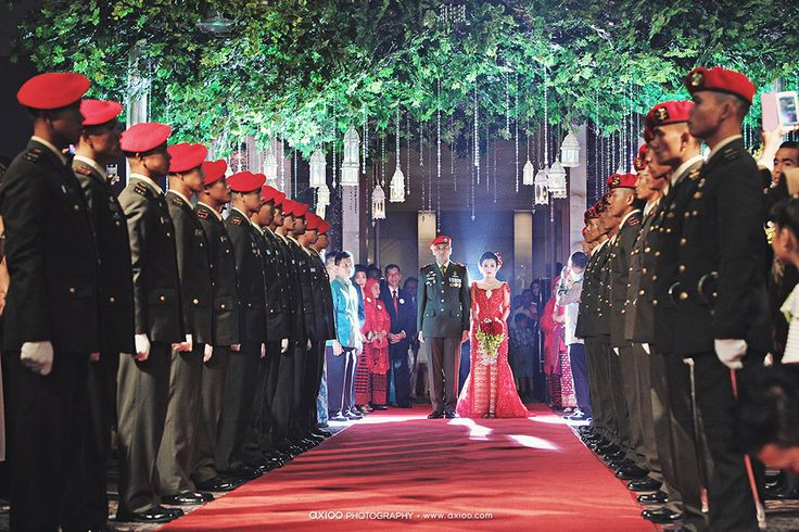 Paulus and Novella is a couple whose hearts are full of national pride. On their wedding day, they were proudly incorporating military ceremony and traditional Batak culture. Take a look at the grand wedding album inside the gallery. on http://www.bridestory.com/blog/one-couples-patriotic-batak-wedding-in-jakarta