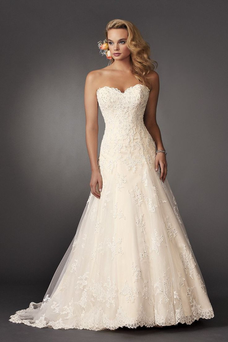 Shown in Diamond White/Bisque…Strapless fit and flare lace gown with sweetheart neckline and semi cathedral train. Removable spaghetti straps included.
