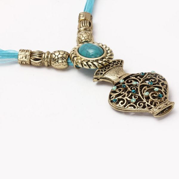Excuisite Stone Embossed Neckpiece Add a zing of style your persona by putting this pot shaped neckpiece around your neck. Blue studs in this charming piece of jewelry will make you shine in the crowd and you will feel like a real star. Visit for buy:- http://khoobsurati.com/khoobsurati/excuisite-stone-embossed-neckpiece-khoobsurati
