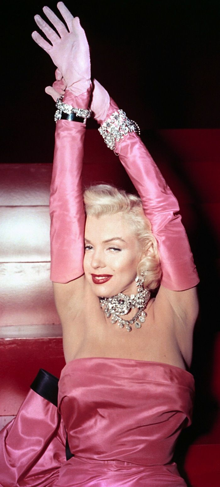 Marilyn Monroe - 'Gentlemen Prefer Blondes' 1953 - William Travilla, costume designer for theatre, film, and television designed her dresses in 8 films. The pink tafetta dress is one of his most famous creations and a celebrated style of evening gowns ever since.