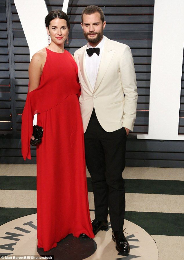 Good looking pair: Jamie Dornan was joined by glamorous wife Amelia at the Vanity Fair Oscar party hosted by Graydon Carter, where they joined the cream of Hollywood following a chaotic end to the prestigious event
