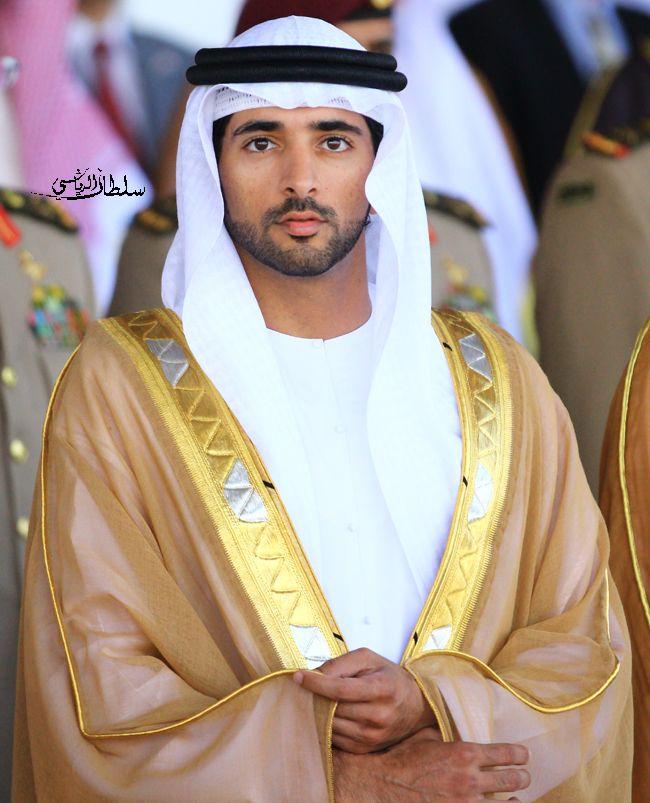 Sheikh Hamdan-Dubai.  White Kandura, gold bisht, white ghutra and black agal.