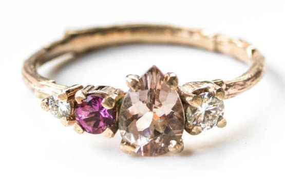 A clustered peach morganite, pink tourmaline, and moissanite ring that'll be the talk of the town. | 31 Stunning Engagement Rings That Aren't Made With Diamonds