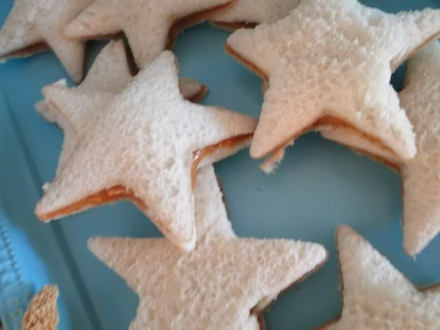 just bread sliced (extra dark rye and other specialty varieties) and cut with cookie cutter into stars, serve with cheese (no pbj)