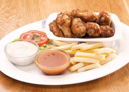 Buffalo Wings. A full portion of chicken wings basted or tossed in Spur's famous Durky Sauce. Served with a portion of chips at Spur Steak Ranches | http://www.spur.co.za/menu/starters