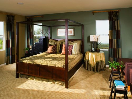 If you and your partner can't agree on decor, mix it up! The mismatched nightstands don't take anything away from this stylish bedroom.