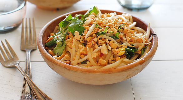 Easy Pad Thai Recipe (makes 2 big bowls): boxed Thai noodles (thick rice noodles work just fine), soy sauce, fish sauce, brown sugar, canola oil, sambal oelek (or sriracha!), eggs, a lime, some bean sprouts, cilantro and scallions, and crushed peanuts. Can add chicken or shrimp, if wanted.