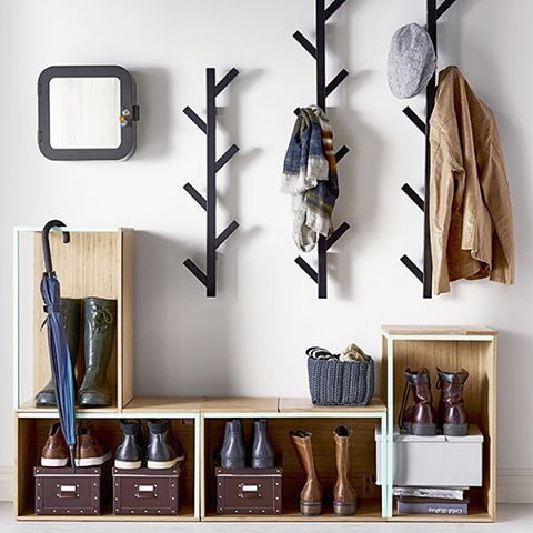 For an organized entryway, create shoe cubbies with IKEA PS 2014 storage modules & make a space to hang your coats with TJUSIG hangers! #StorageIdeas