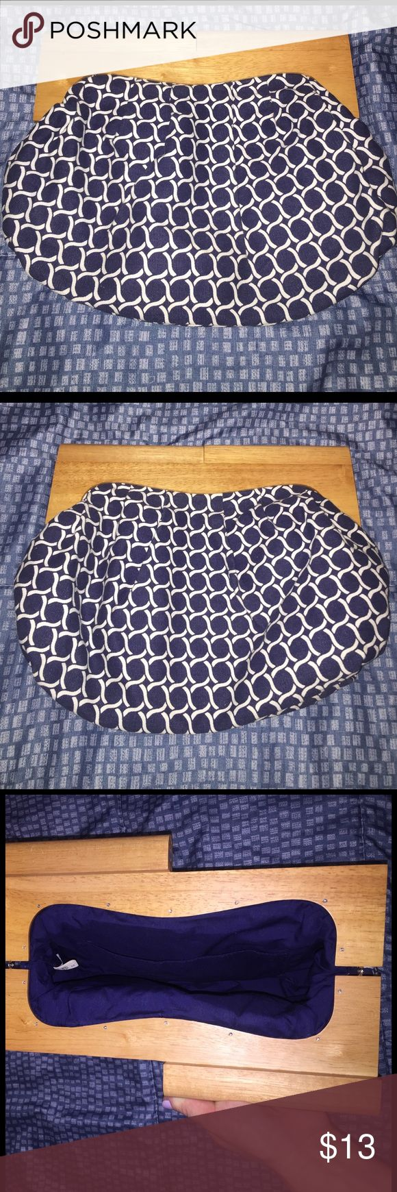 Cute navy and white clutch Excellent condition. Old Navy wooden handle clutch. Fabric is navy blue and white with nautical-type pattern. One big pocket inside bag, too. Spacious and holds a lot! Perfect for your spring wardrobe! Old Navy Bags Clutches & Wristlets