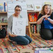 Pauline, our Auslan Interpreter, interpreting Tracie Grimwood Illustrator's instructions on how to draw a dog. Reena's Rainbow workshop at Squishy Minnie bookstore in Kyneton