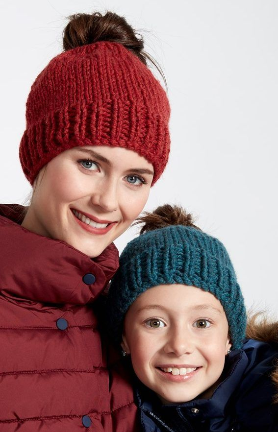 Free Knitting Pattern for Family Fun Messy Bun Hats - Easy hats by Bernat are a quick knit in bulky yarn. Adult and child sizes.