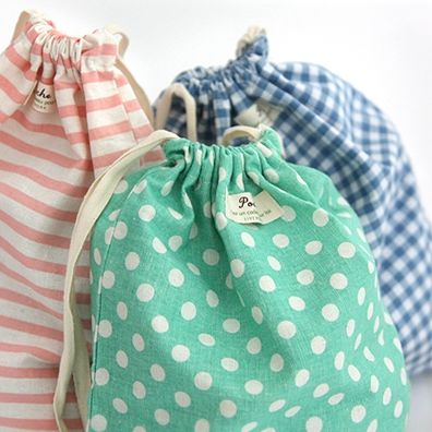 Pattern Cotton Pouch - These would be so cute for travel (to corral jewelry, unmentionables, or even shoes.)