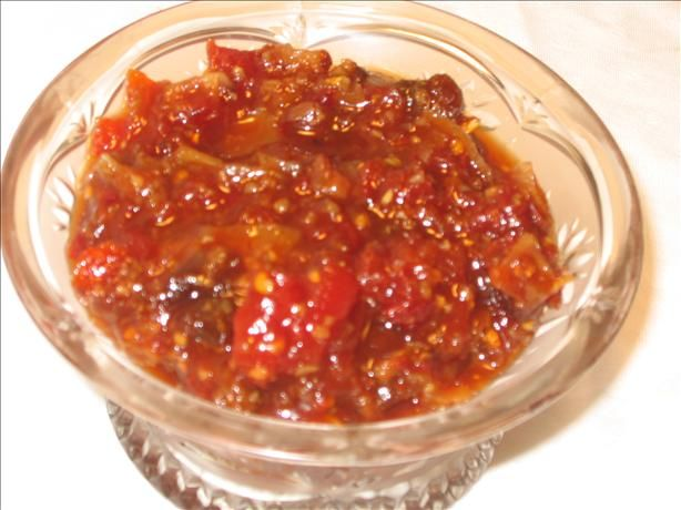 Sweet Tomato Chutney from Food.com:   From 'An Invitation to Indian Cooking' by Madhur Jaffrey. This is one of Madhur Jaffrey's favorite sweet chutneys, she always spoons out a small bowl for all her dinner parties. It goes with almost all foods and is very popular. Store, bottled, in the refrigerator. It keeps for months.