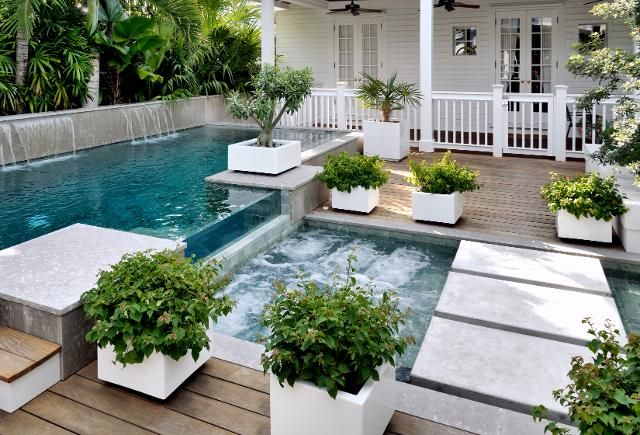 cool idea for small backyard...infinity lap pool and jetted spa