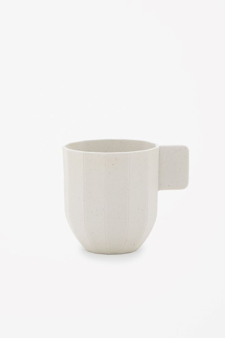 This coffee cup is made from lightweight porcelain with hand-decorated specks of iron, designed to look like folded recycled paper.