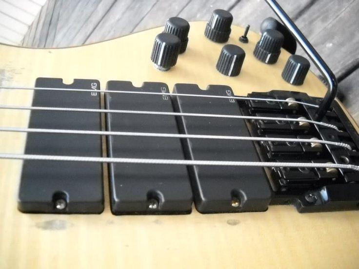 Custom Schecter bass guitar with a Kahler 2410 bass tremolo with rearward saddles