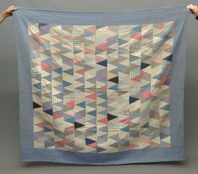 """C. 1900's Penna. printed triangles quilt. 62"""" x 70""""."""