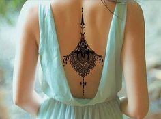 tatuaje temporal espalda