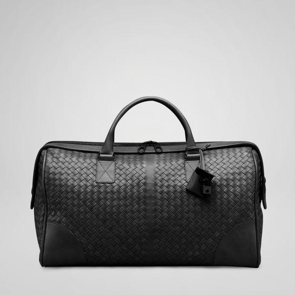Nero duffle bag by Bottega Veneta. It is even cooler in navy blue.