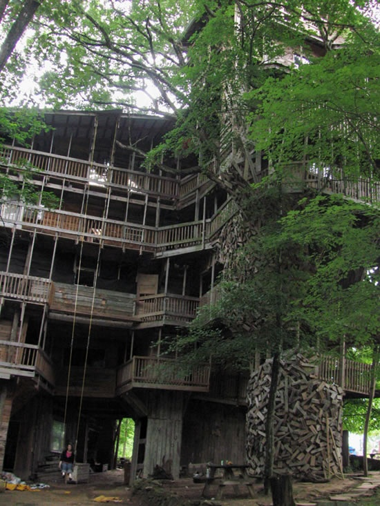 Located in Crossville, Tennessee, this treehouse took Horace Burgess 14 years to build it around an 80-foot-tall white oak tree, with a diameter of 12 feet.