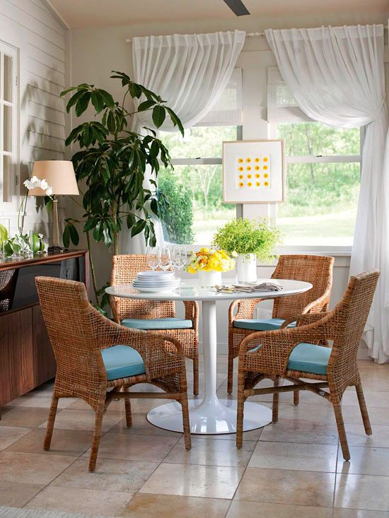 Add the functionality of a dining room to an enclosed porch with a few basic…